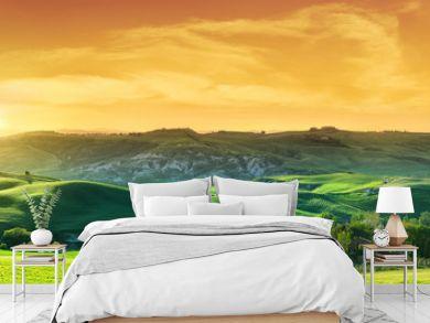 Idyllic view, green Tuscan hills in light of the setting sun