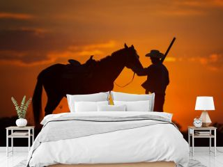 Cowboy silhouette And horses in the evening, sunset