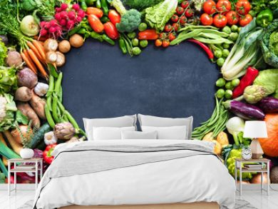 Food background with assortment of fresh organic vegetables
