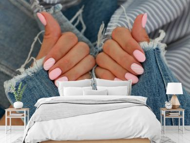 Pink matte oval shaped manicure on jeans background