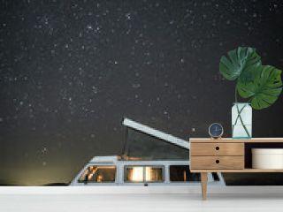 Camper Van On Field At Night
