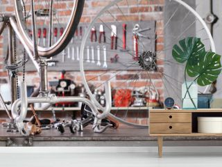 vintage bicycle in garage workshop on the workbench with tools, diy and repair concept