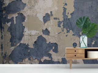 An old concrete wall with a discolored paint. Surface painted, rough, weathered, patterned, cracks and peeling.