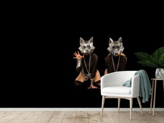 Two go-go variety show dancers in wolf masks on black