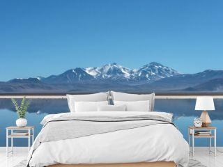 Snow covered Nevado (volcano) Tres Cruces reflecting in a high-altitude lake Laguna Santa Rosa in Parque Nacional Nevado de Tres Cruces, Chile,  Atacama desert