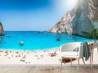 Panoramic view of the famous Navagio shipwreck beach on Zakynthos island, Greece, with people enjoying the light blue colored sea