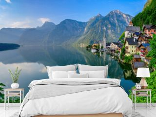 Hallstatt, Austria   July 31, 2021 - A scenic picture postcard view of the famous village of Hallstatt reflecting in Hallstattersee lake in the Austrian Alps.