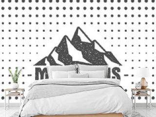 Hand drawn wilderness old style typography poster with retro mountains. Letterpress Print Rubber Stamp Effect. Halftone hand drawn background. Mountain label. vintage mountains badge design