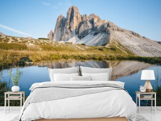 Famous Tre Cime di Lavaredo reflected in small pond, Dolomites Alps Mountains, Italy, Europe. Tre Cime mount in Dolomites