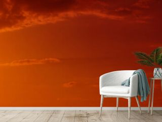 Orange red sunset. Toned sky with clouds. Gradient. Colorful sky background with copy space for design. Wide banner. Website header.