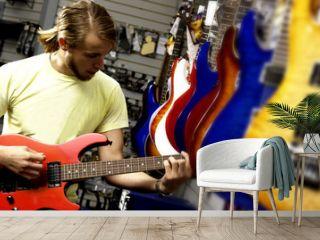 Man at guitar store