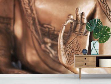 Die Hand des Messing-Buddhas