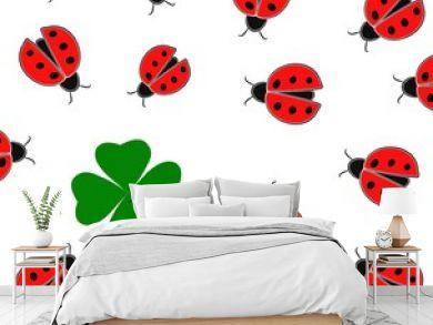Red ladybugs and green shamrock