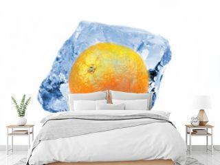 Orange frozen in ice cube, isolated on white background