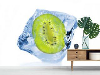 Frozen slice of kiwi in ice cube