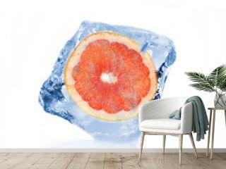 Frozen slice of grapefruit in ice cube