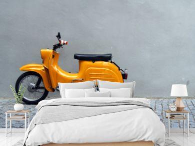 Yellow Motorbike by Grey Concrete Wall
