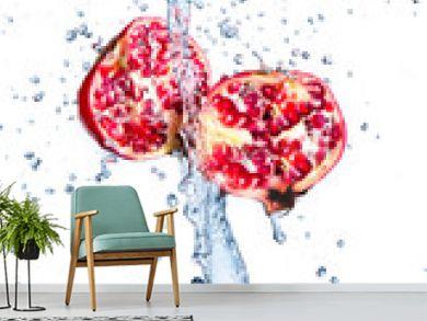 Fresh pomegranate in water splash