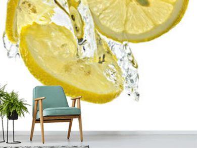 Lemon slices in water splash, white background, isolated
