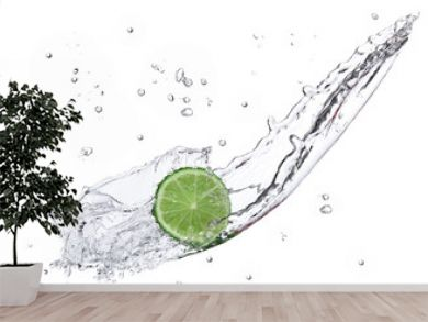 Fresh lime with water splash isolated on white