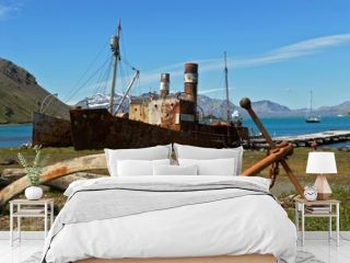 Rusting wrecks of old whaling ships beached in Grytviken,