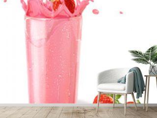 Strawberries splashing into a milkshake glass, with two others o