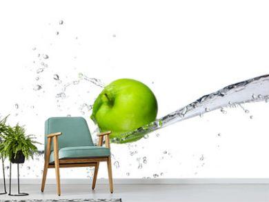Fresh apple with water splashing, isolated on white background