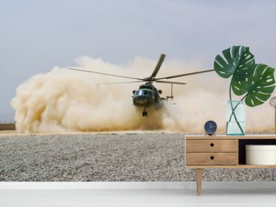 helicopter landing in cloud of dust of desert