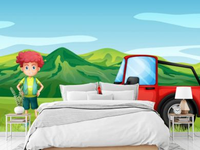 A red jeepney and a boy in the hills