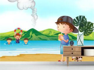Kids swimming and a boy and his pet at the seashore