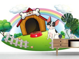 A dog with a dog house and a dog food inside the fence