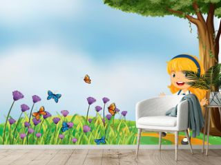 A young school girl in the garden with butterflies