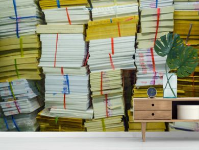 stack of old books and documents