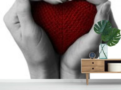 Red heart in cupped hands.
