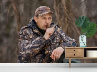 duck hunter with a wooden duck call