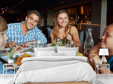 Family Enjoying Meal In Restaurant