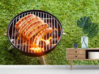 Sausages grilling on a portable barbecue