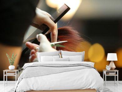 Barber cutting brown hair