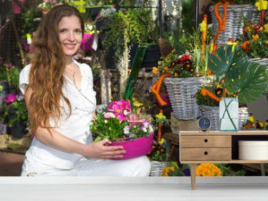 Woman in flower shop among flower arrangements