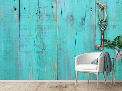 Skeleton key hanging on teal blue wood door