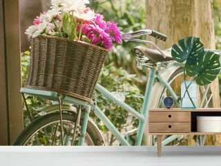 Vintage bicycle with flowers in front basket