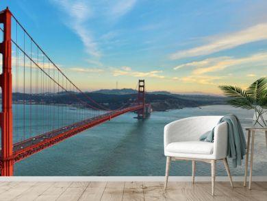 Golden Gate Bridge panorama, San Francisco California, sunset light on cloudy sky