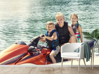 Group of People enjoying a ride on a personal watercraft on a warm summer day on the lake