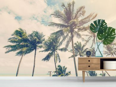 coconut plam tree on beach of nature background in vintage style