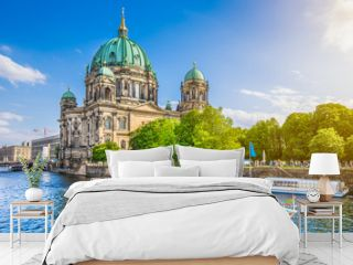 Famous Berlin Cathedral at Museumsinsel with excursion boat on Spree river at sunset, Berlin, Germany