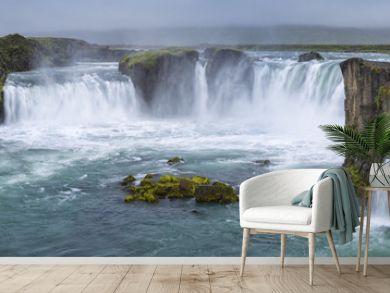 panorama of waterfall with clouds in Iceland