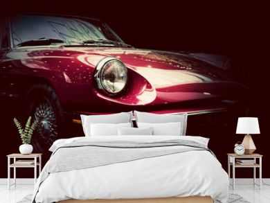 Retro classic car on dark background. Vintage, elegant