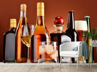 Bottles and glasses of assorted alcoholic beverages