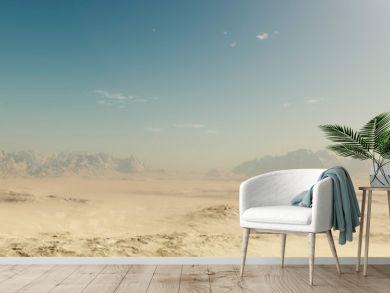 Sandy desert landscape with blue sky.