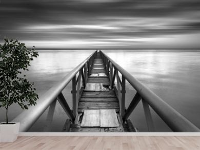 Bridge to the infinitive point over a sunset